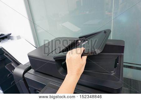 businesswoman lift the printer feeder by hand