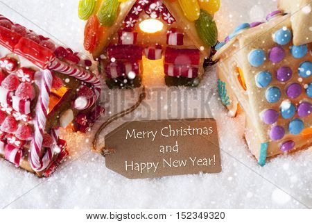 Label With English Text Merry Christmas And Happy New Year. Colorful Gingerbread House On Snow And Snowflakes. Christmas Card For Seasons Greetings