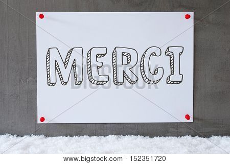 Label With French Text Joyeux Noel Means Merry Christmas. Urban And Modern Cement Wall As Background On Snow