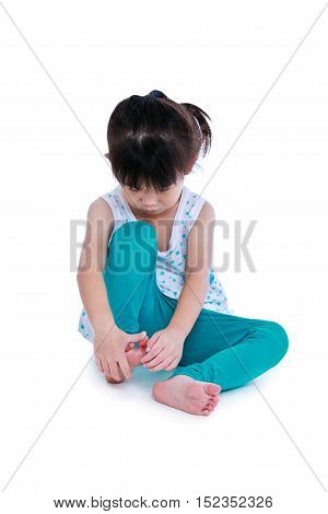 Full body of sad asian child injured at right toenail. Isolated on white background. Studio shot. Human healthcare and problem concept.