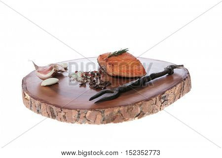 breakfast delicious portion fresh roast salmon fillet dry spices garlic rosemary on wooden plate black forged handmade fork healthy food diet cooking concept isolated on white background empty space