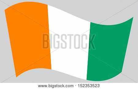 Cote D Ivoire national official flag. African patriotic symbol banner element background. Correct colors. Flag of Ivory Coast waving on gray background vector