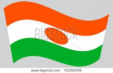 Nigerien national official flag. African patriotic symbol banner element background. Correct colors. Flag of Niger waving on gray background vector