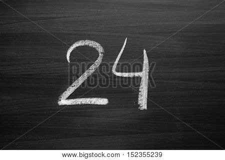 number twenty four enumeration written with a chalk on the blackboard