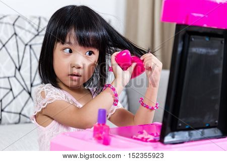 Asian Chinese Liitle Girl Playing With Make-up Toys