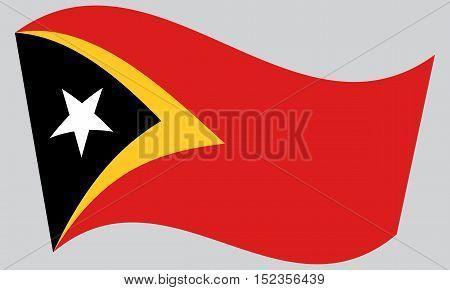 East Timorese national official flag. Patriotic symbol banner element background. Correct colors. Flag of East Timor waving on gray background vector