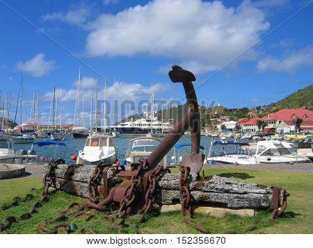 ST BARTS, FRENCH WEST INDIES - JANUARY 22, 2005: Giant anchor at Gustavia waterfront at St Barts. The island is popular tourist destination during the winter holiday season