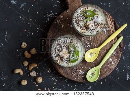 Healthy smoothie cups with super food ingredients. On a dark background top view