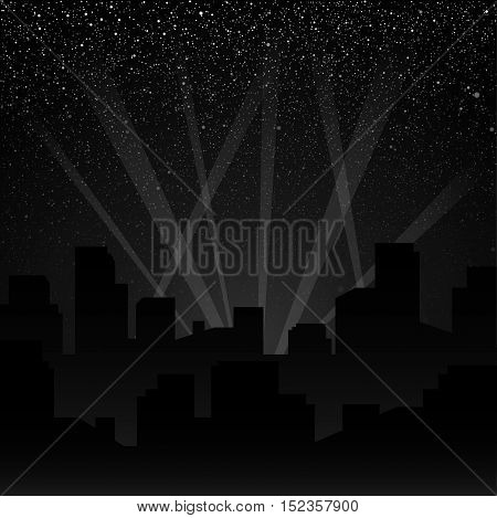 Silhouette of the city. The rays of spotlights over the city.