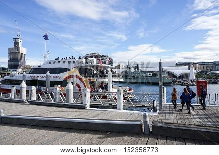 people on the boardwalk to enter the cruise at Darling Harbour taken in Sydney Australia on 6 July 2016