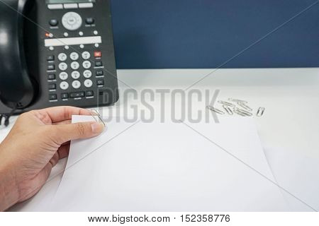 woman with mock up paper sheet and paper clip attach