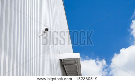 CCTV surveillance security camera video equipment in factory warehouse and industrial building on wall for safety system area control outdoor with copyspace