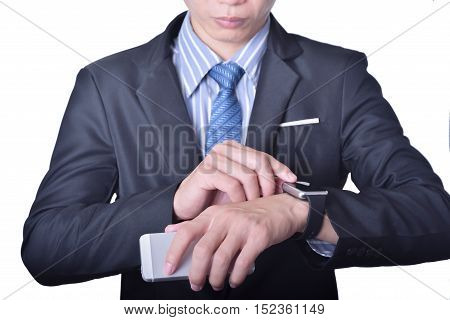 Business Man uses mobile phone and smart watch information