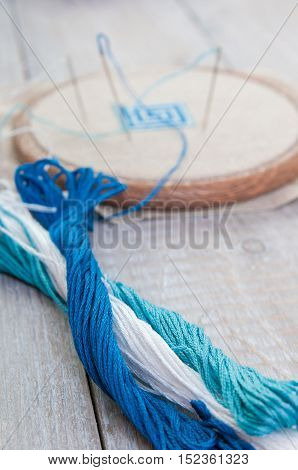 Set for embroidery, embroidery hoop and embroidery thread, selective focus