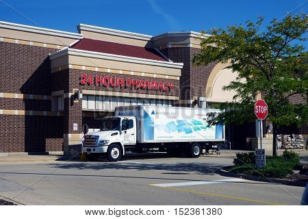 JOLIET, ILLINOIS / UNITED STATES - SEPTEMBER 19, 2016: An Iron Mountain Information Management truck is parked outside of a Jewel Osco store in Joliet.
