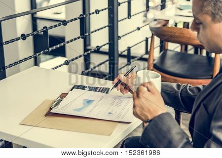 Business Man Studying Graph Report Concept