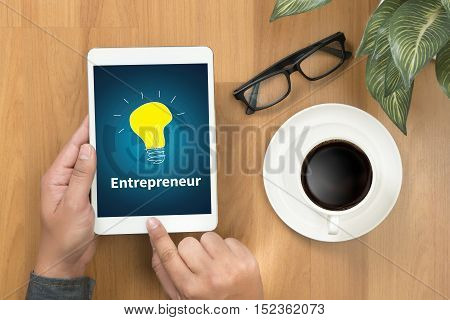 Entrepreneur Team Working In  Office.  Using Digital Tablet And Laptop With Smart Phone On  Working