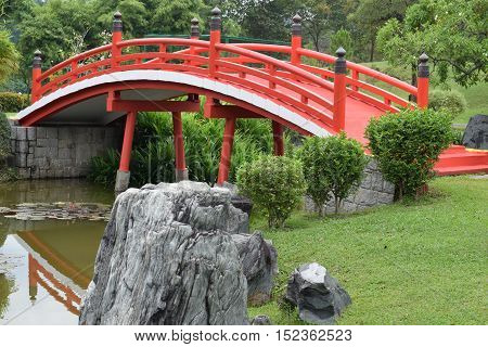 A beautiful zen red bridge at Singapore Japanese Garden
