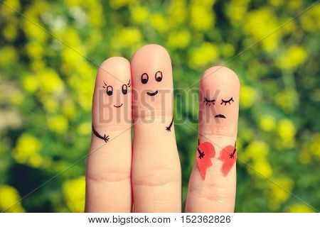 Finger art of Happy couple hugging. Other girl is holding a broken heart. Toned image