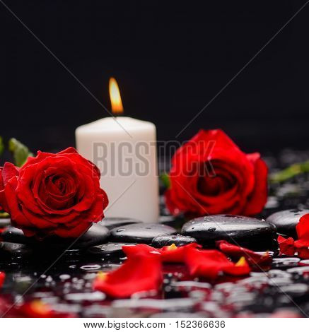 Still life with two red rose with candle and therapy stones