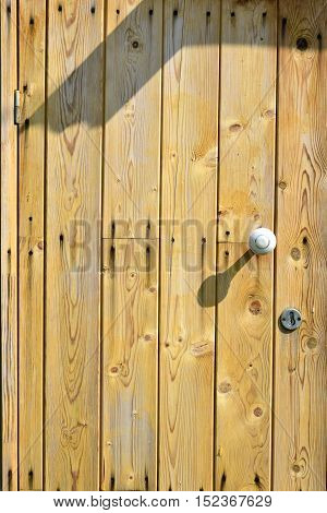 The front door of the bright lacquered boards.