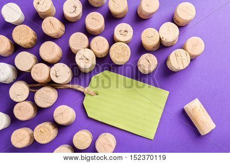 Wine cork stoppers with green label on purple background