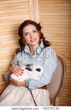 Pretty girl with a bunny in his arms. Pets. Love to the animals.