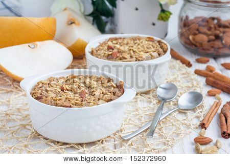 Baked oatmeal with nuts almond milk honey spices and asian pear horizontal
