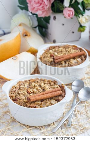 Baked oatmeal with nuts almond milk honey spices and asian pear vertical