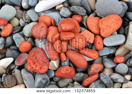 red stones on a pebble beach background
