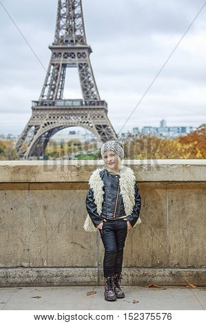 Smiling Trendy Child In Front Of Eiffel Tower In Paris, France