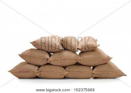 Pile of burlap sacks isolated on white background