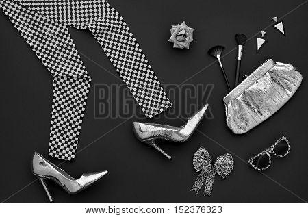 Fashion woman Clothes Accessories Set. Fashion Design Outfit. Black White. Stylish Leggings, Glamor fashion Heels, Handbag Clutch, Trendy Sunglasses. Fashion Cosmetic. Top view. Minimal. Monochrome