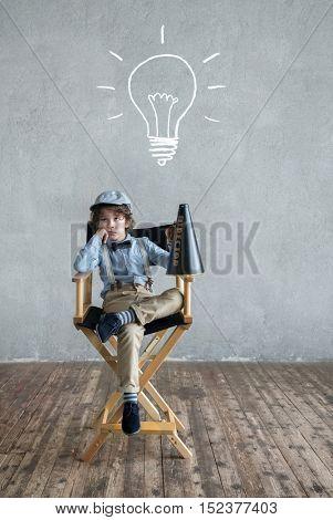 Little director with a speaker in studio