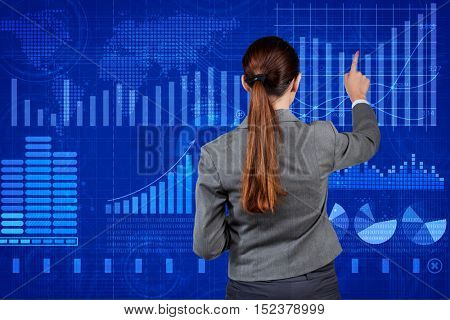 Businesswoman in stock exchange trading concept
