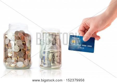 jar with coins and money, credit card in hand isolated on white background