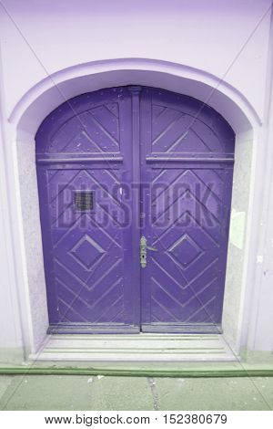 purple painted wooden door.