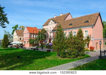MINSK BELARUS - OCTOBER 1 2016: Beautiful autumn view of houses in Trinity Suburb Minsk Belarus. Unidentified people walk outdoors on sunny autumn day