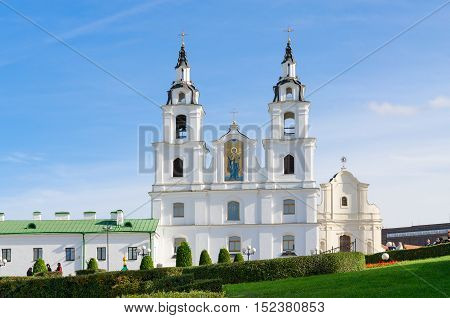 MINSK BELARUS - OCTOBER 1 2016: Cathedral of Descent of Holy Ghost (Holy Spirit Cathedral) Minsk Belarus. Unidentified people walk outdoors on sunny autumn day
