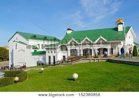 MINSK BELARUS - OCTOBER 1 2016: Church of St. Cyril of Turov spiritual and educational center of Belorussian Orthodox Church. Unidentified people walk outdoors on sunny autumn day