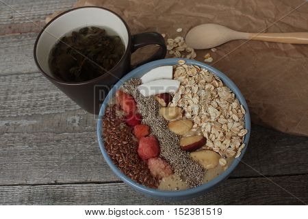 Breakfast berry smoothie bowl topped with raspberries, Chia, flax seeds, coconut, Brazil nut