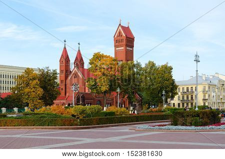 MINSK BELARUS - OCTOBER 1 2016: Unidentified people are near Catholic Church of Saints Simon and Helena (Red Catholic Church) Minsk Belarus