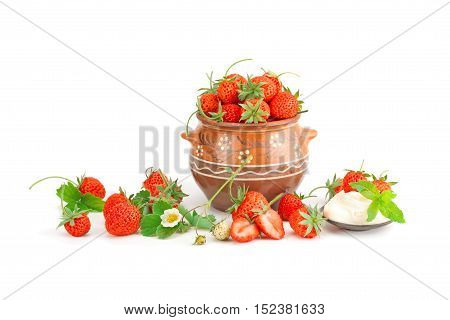 Strawberries with cream isolated on white background.