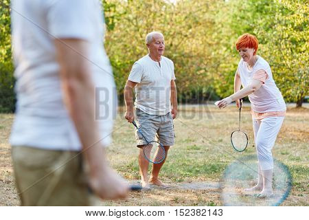Active seniors playing in the park and having fun