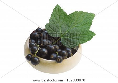 Black currants in a basket, isolated on white background