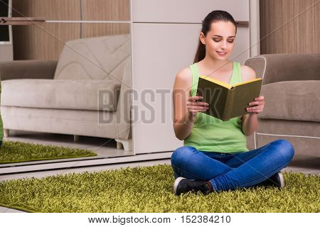 Young woman reading books at home