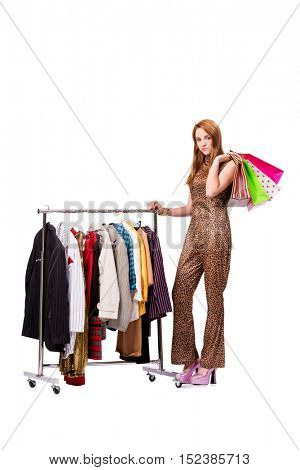 Young woman in shopping concept on white