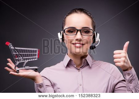 Young sales operator in telesales teleshopping concept