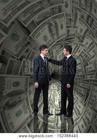 Businessman fighting against dollar funnel
