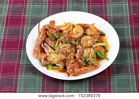 Stir-fried crab and shrimp in curry power is top-ten of popular Thai food as seafood to fried with  fresh milk ,grill curry ,egg ,oyster oil and yellow curry powder.